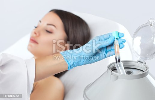 istock The blood tube is removed from the medical centrifuge for plasma lifting. 1129897331