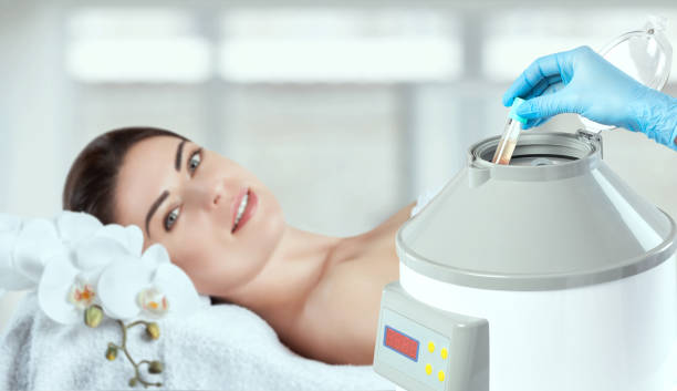 The blood tube is removed from the medical centrifuge for plasma lifting. Prp procedure. stock photo