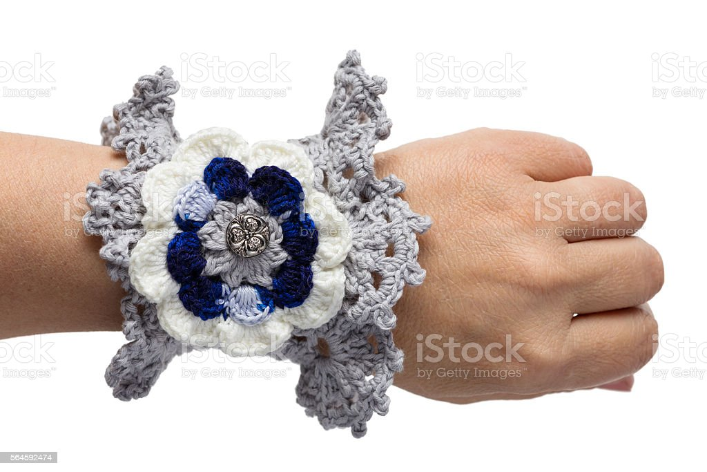 The blue bracelet embroidered with threads stock photo