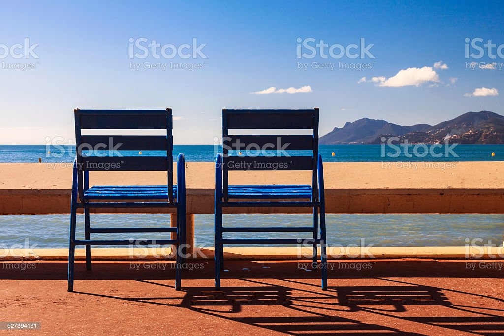 The blue chairs on the Croisette of Cannes Film Festival stock photo