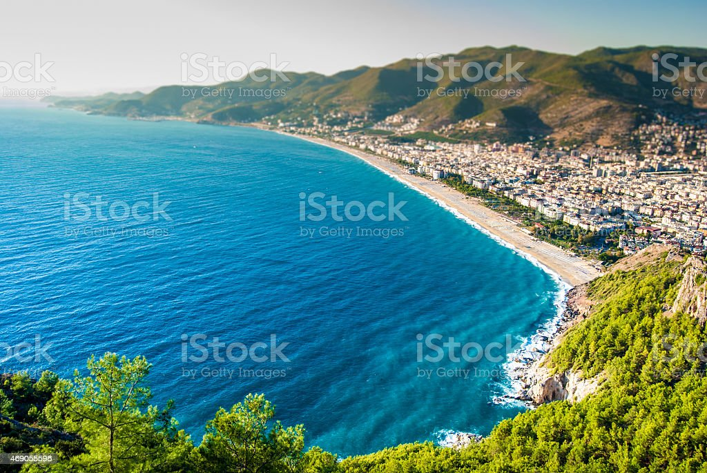 The blue coast of Alanya seen from a mountain stock photo