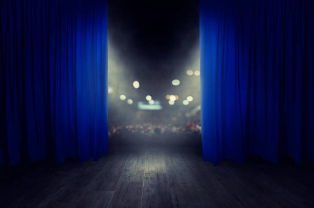 The blue curtains are opening for the theater show The blue curtains of the stage are opening for the theater show theatrical performance stock pictures, royalty-free photos & images