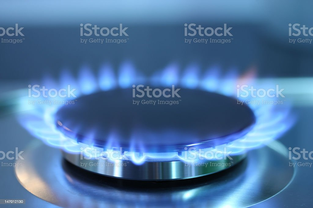 The blue flames of a gas burner stock photo