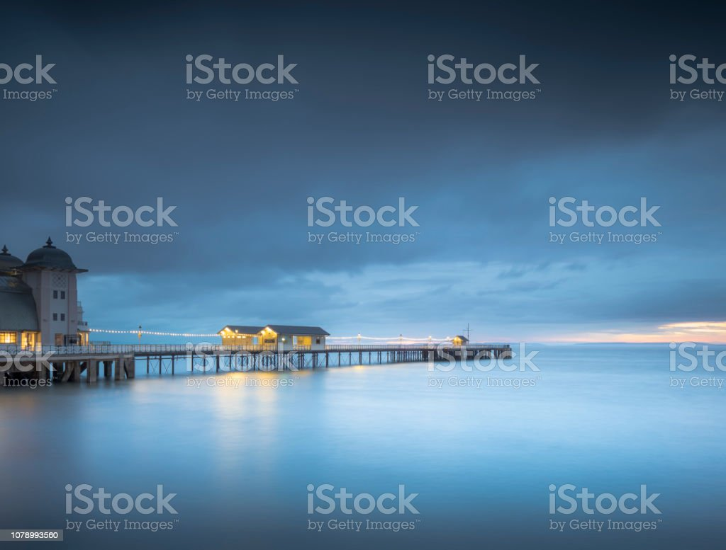 The blue hour at Penarth Pier, Wales. stock photo