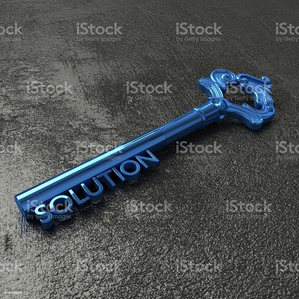 The blue key to solutions on a black stone table stock photo