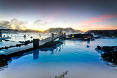 The sun was rising at the blue lagoon and it was a delight to swim in the warm baths with the outside temperature around zero degrees created a slight mist in the air as the cold air made contact to the warm water.