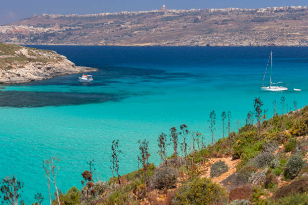 The Blue Lagoon on the small island of Comino off the coast of Gozo - Malta stock photo