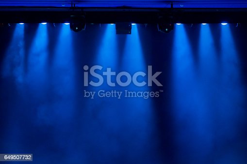 istock The blue light from the spotlights through the smoke in the theatre during the performance. Lighting equipment. 649507732
