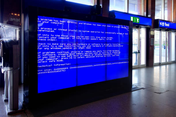Rome, Italy - Jan 2015: The Blue Screen of Death in the video wall at termini railway station in Rome that is an error screen displayed after a fatal system error in the computer stock photo