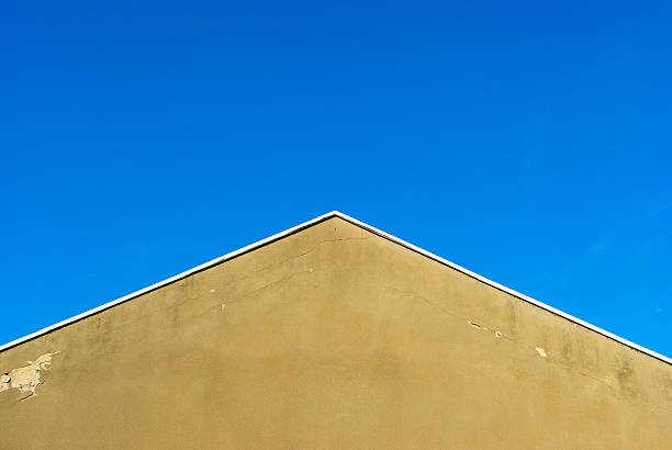 The blue sky above The blue sky and the culmination of a roof. cusp stock pictures, royalty-free photos & images