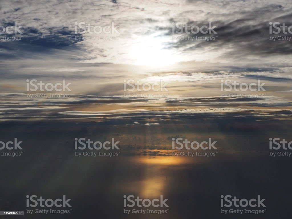 The blurred sky background before sunrise,with smoky and waving cloud,foggy cloud, reflection of sunlight ,beautiful top view sky. royalty-free stock photo