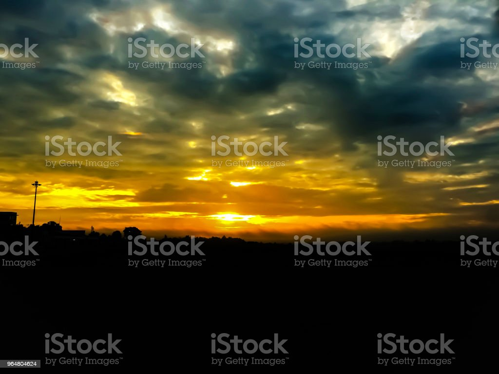 The blurry design background of sky before sunrise,glamour glow tone,dramatic tone,art style,reflection from sunlight ,smoky cloud,beauty and  colorful background. royalty-free stock photo
