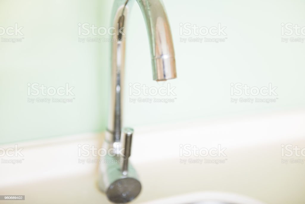 The blurry dripping faucet. stock photo