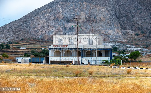 Perissa, Greece - July 14 2019:   The boarded up  centre for an abandonded Go Kart track on the Perissa Fira road