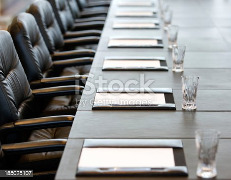 istock The boardroom table is set for a meeting 185025107