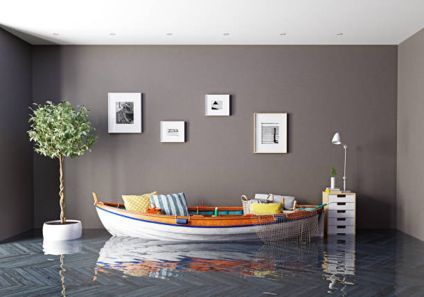 the boat as a sofa in flooding interior - flooded room stock photos and pictures