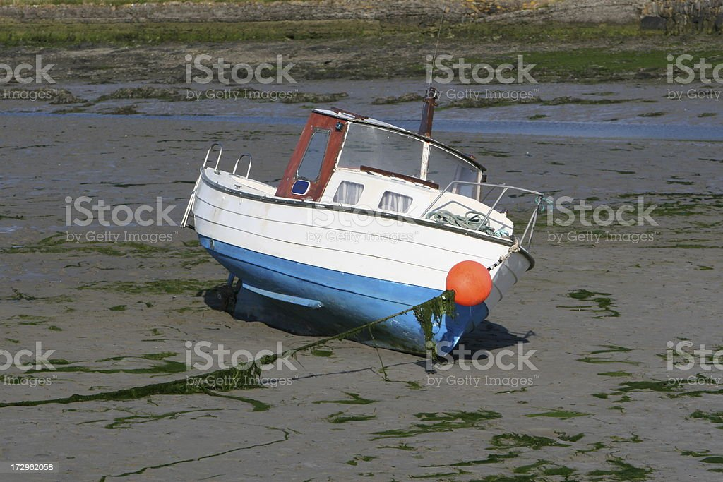 The Boat, beached at Low Tide, Ireland stock photo