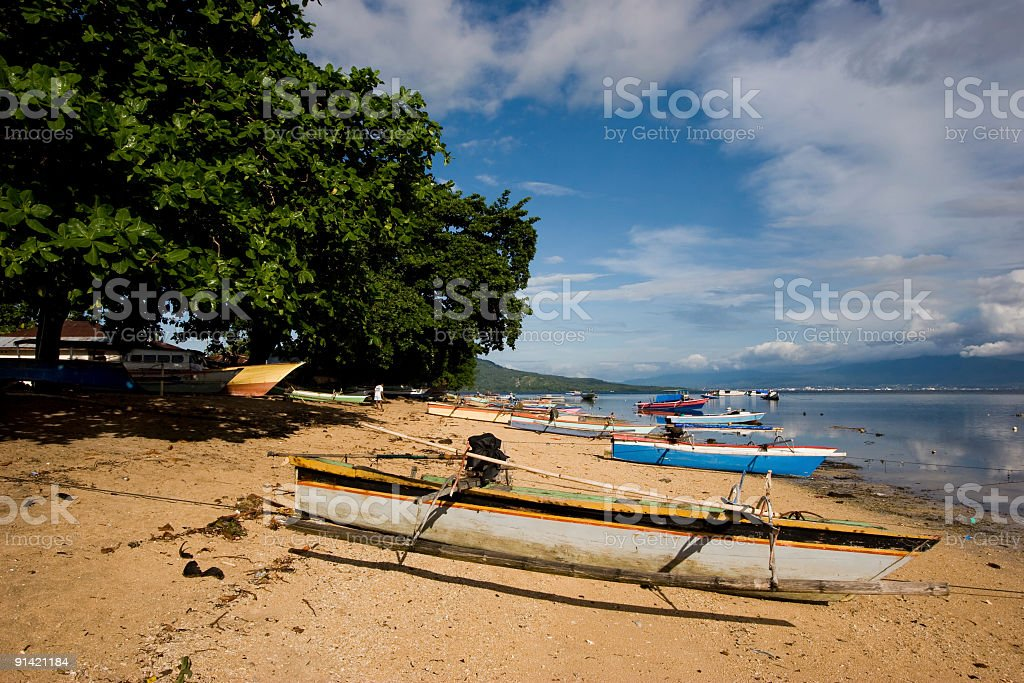 The boats of Bunaken village: sunny day at low tide royalty-free stock photo