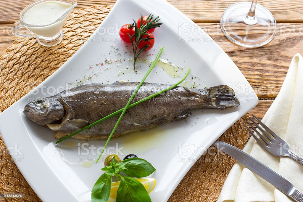 the  boiled rainbow trout with fresh vegetables stock photo