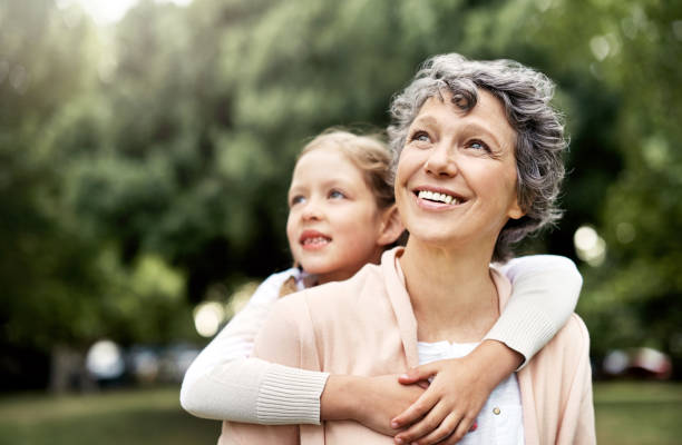 the bond between grandparent and grandchild is uniquely special - granddaughter and grandmother stock photos and pictures