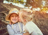 Shot of two little children playing together outdoors