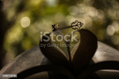 The book and the key to knowledge on the background of the tithe-orange bokeh