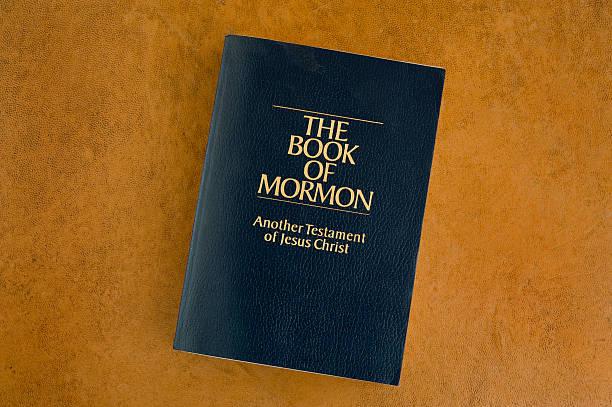 The Book of Mormon on an orange background stock photo