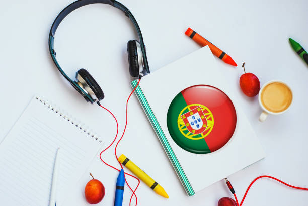the book with Portuguese flag and headphones. concept of Portuguese learning through audio courses stock photo