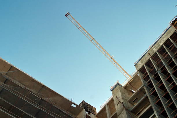 The boom of a construction crane on blue sky background. stock photo