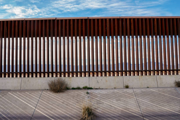 The Border Wall Along The Texas and Mexico Border The fence or wall dividing the countries of the USA and Mexico international border barrier stock pictures, royalty-free photos & images
