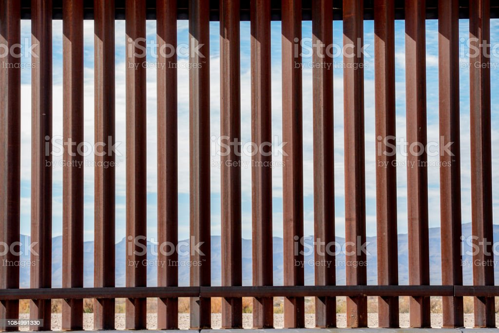 The Border Wall Along The Texas and Mexico Border The fence or wall dividing the countries of the USA and Mexico Barricade Stock Photo