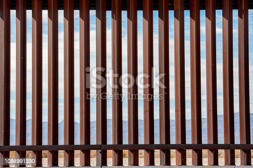 The fence or wall dividing the countries of the USA and Mexico