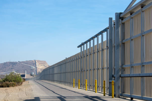 The border wall on the United States - Mexico international border The border wall on the United States - Mexico international border near San Diego in California under blue sky international border barrier stock pictures, royalty-free photos & images