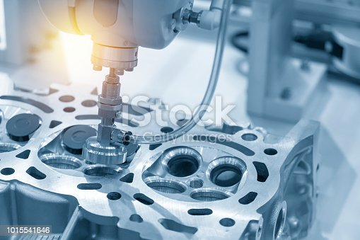 istock The boring machine make the hole at the cylinder head in the light blue scene.. 1015541646
