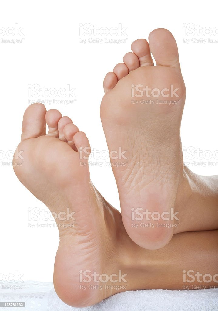 The bottom of a woman's feet isolated on white stock photo