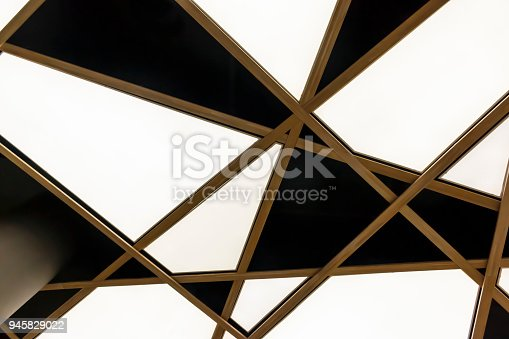 istock The bottom view of the modern white triangular ceiling 945829022