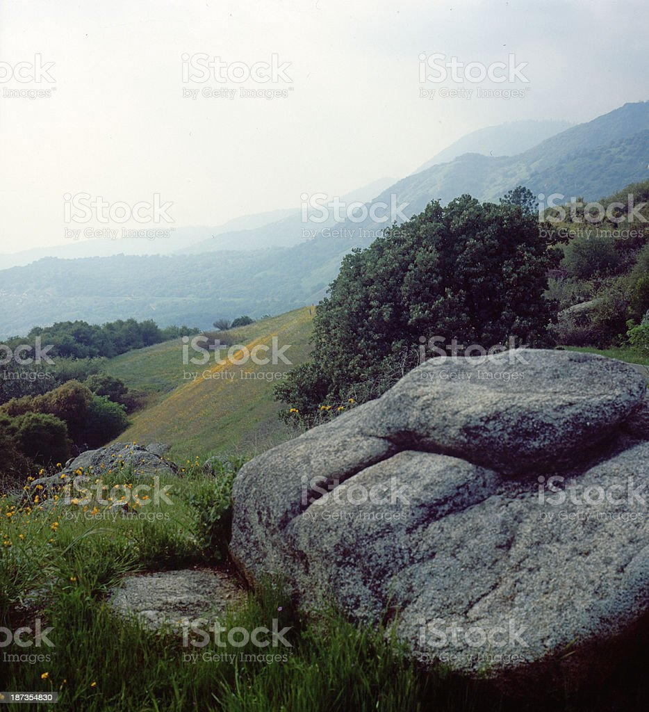 The boulder and rolling hills royalty-free stock photo