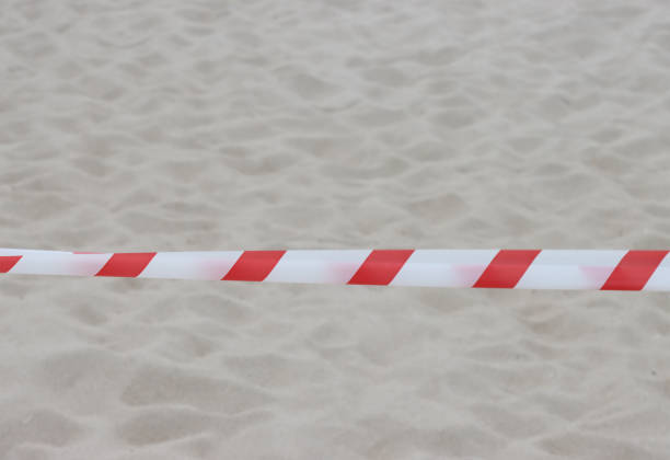 The boundary tape on the beach. stock photo