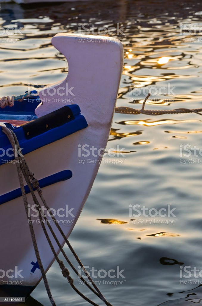 The bow of a fishing boat at sunset in Porto Koufo harbor, Sithonia royalty-free stock photo