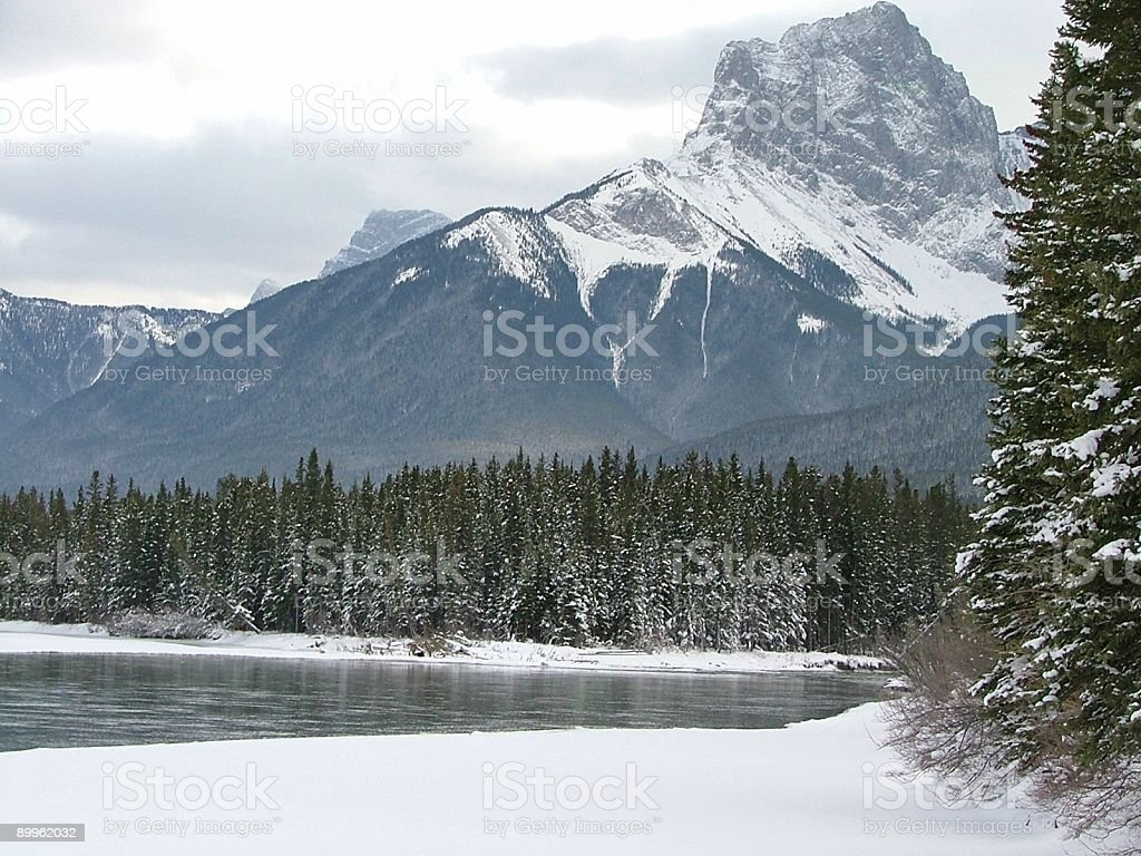 The Bow River and Three Sisters in Snow royalty-free stock photo