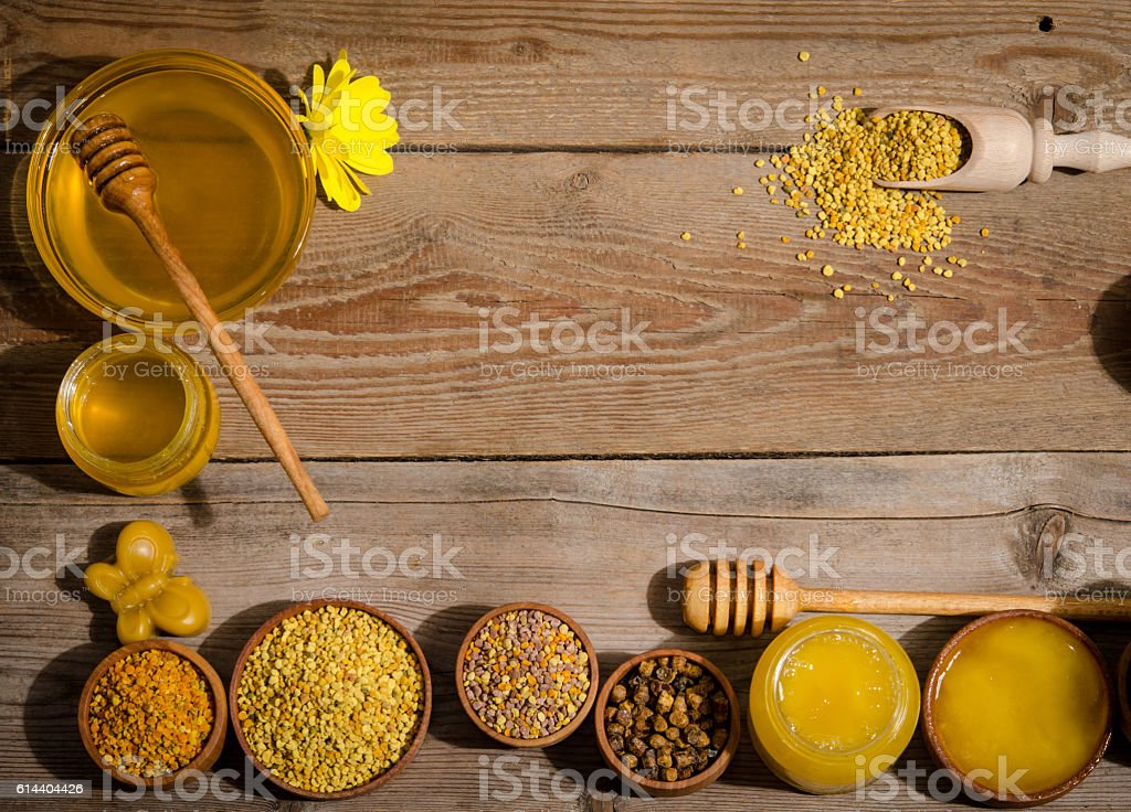 the bowls with honey and pollen on a wooden table stock photo