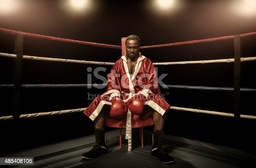 Boxer sitting on the corner of boxing ring