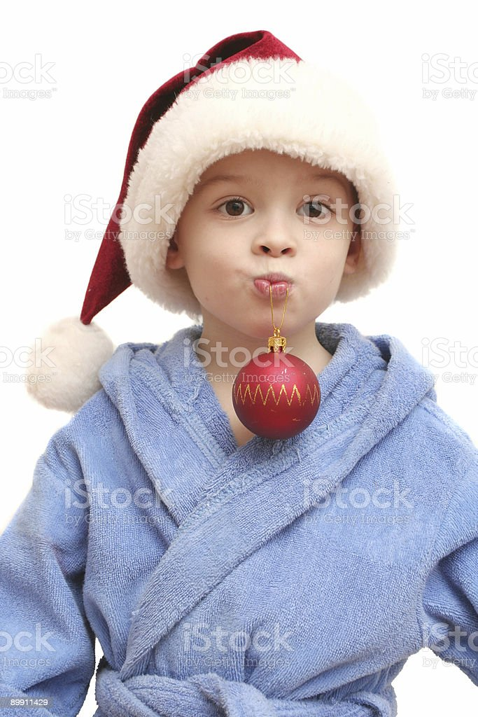 The boy in a New Year's cap royalty-free stock photo