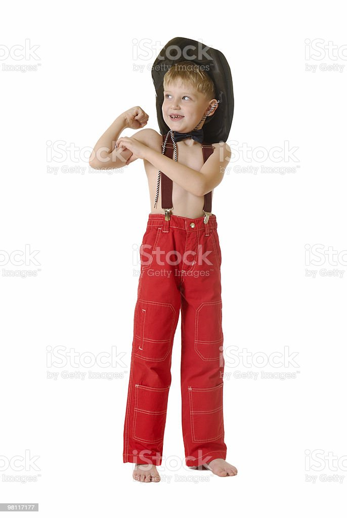 The boy in clothes of cowboy royalty-free stock photo