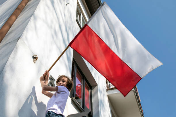 The boy is hanging a flag. Polish National Day of the Third of May, Constitution Day Flag Day, International Labor Day polish culture stock pictures, royalty-free photos & images