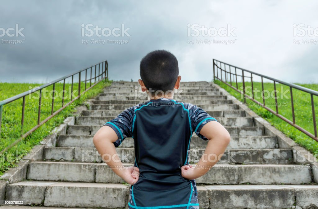 The boy is ready to run stock photo