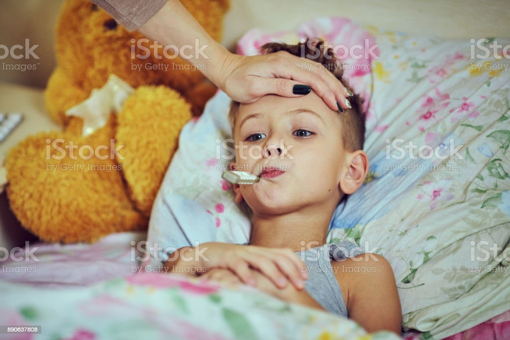 The boy is undergoing treatment in the hospital. stock photo