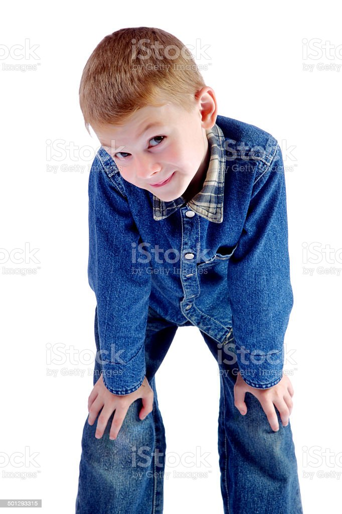 The boy looks with a malicious look stock photo