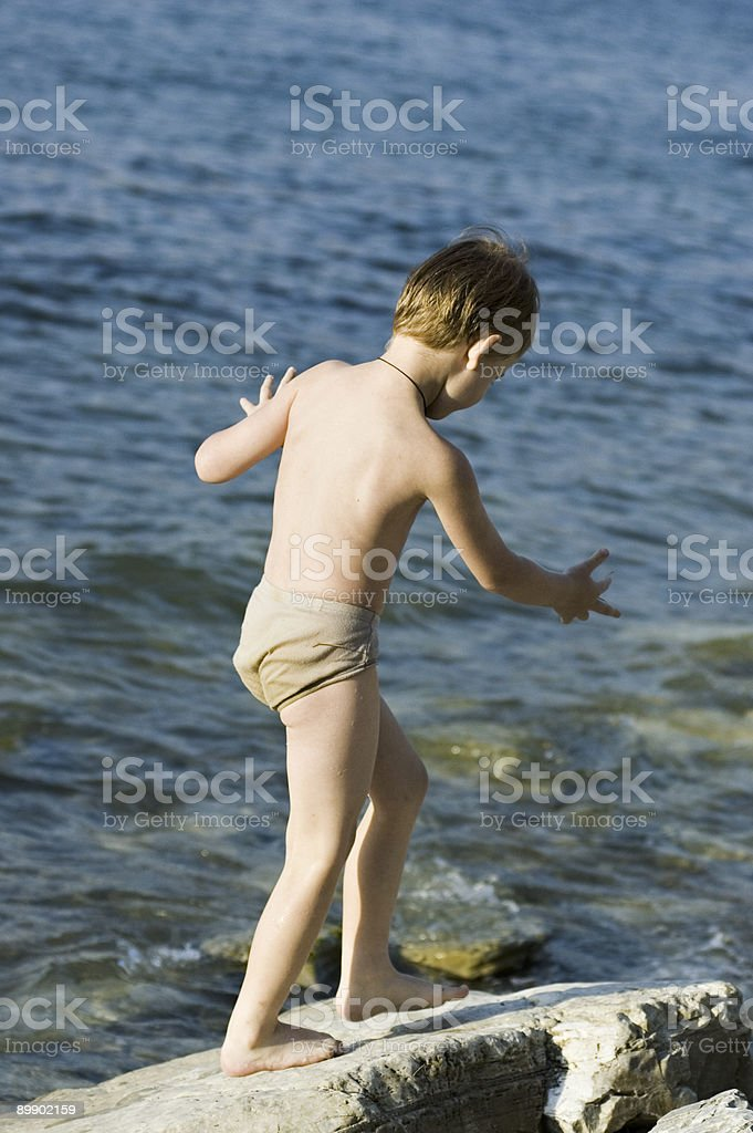 The boy on a sea royalty-free stock photo