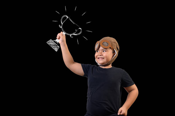The boy pretended to be a superhero and carried a trophy. Draw concept. stock photo